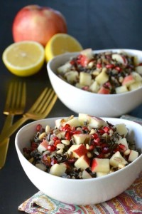 Wild Rice Salad with Apple and Pomegranate in white bowls.