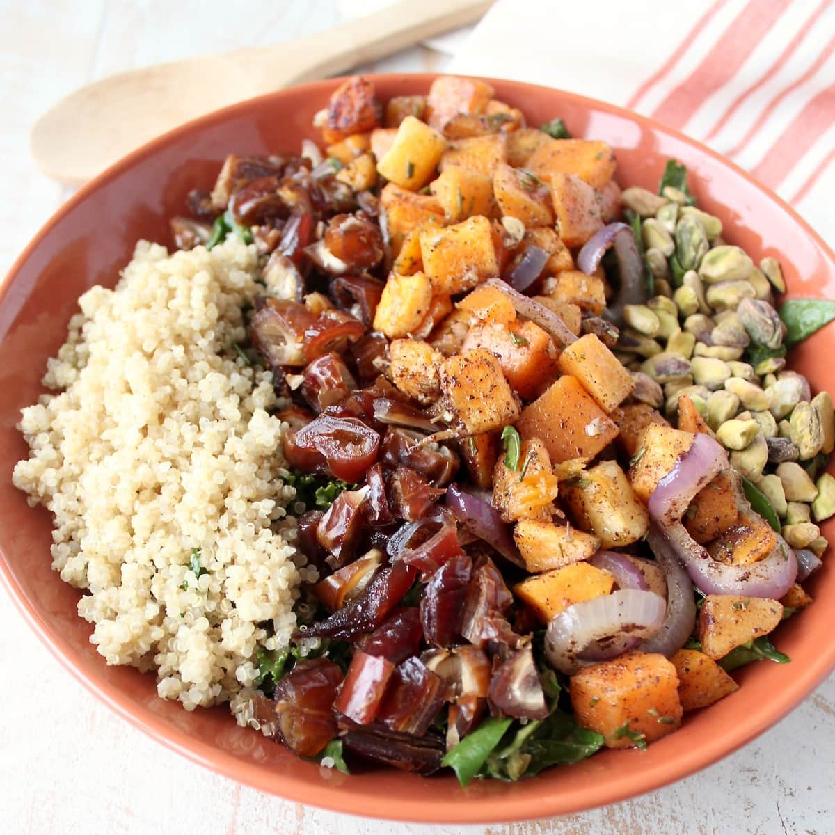 Butternut squash kale salad with pistachios and medjool dates.
