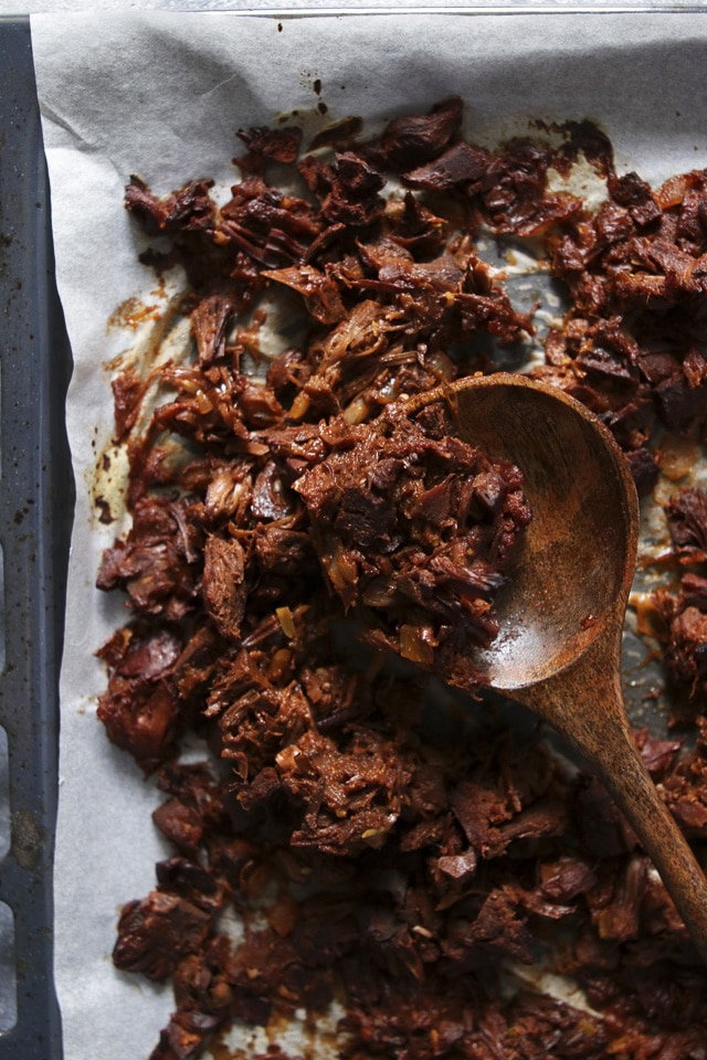 Pulled Jackfruit on a Baking Tray with a Wooden Spoon