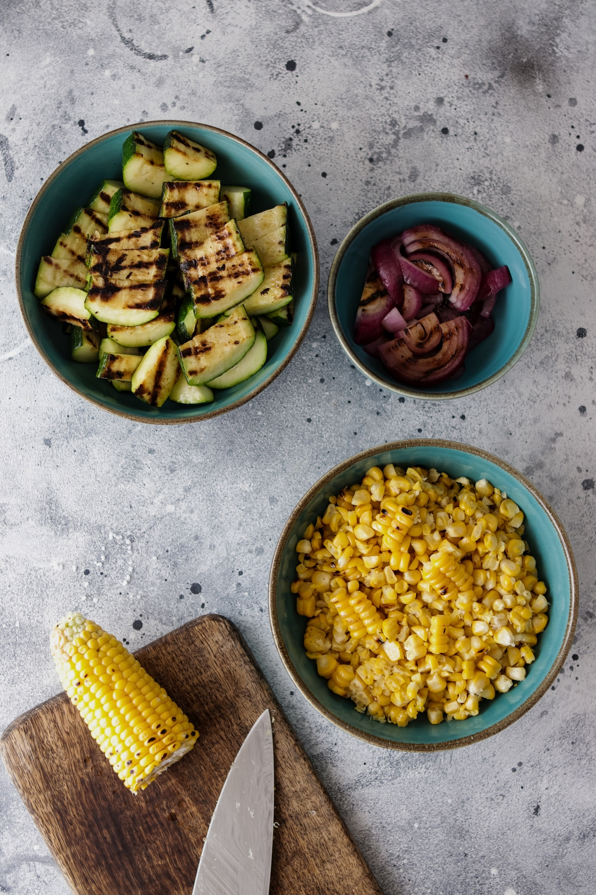 Chopped Zucchini Grilled-Corn-and-Onion-in-Separate-Bowls