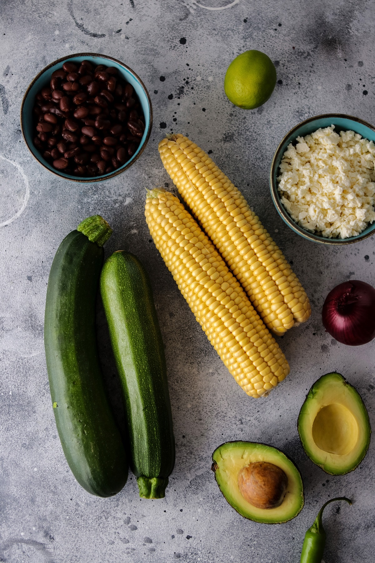 Ingredients for the Salad, Zucchini, Corn, Black Beans, Avocado, Feta Cheese and Red Onion