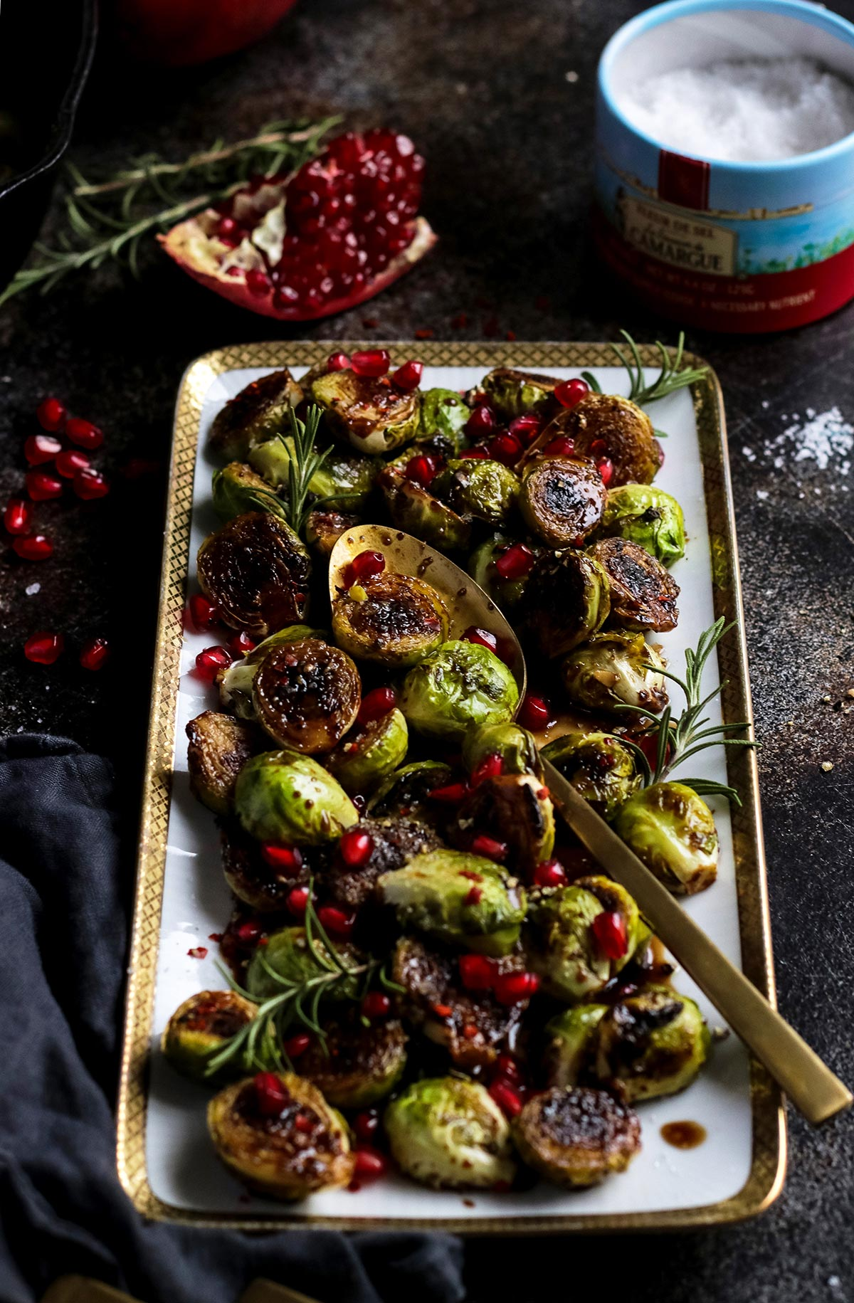 Maple Glazed Brussel Sprouts Garnished with Pomegranate Seeds.