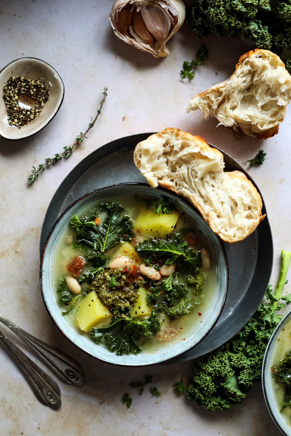 Kale Tuscan soup in a bowl with bread.
