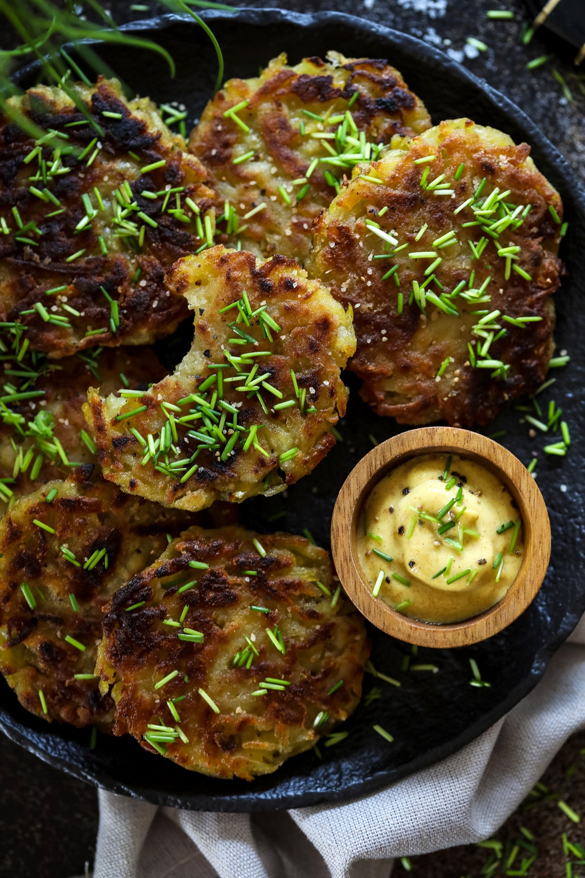A Plate with German Potato Pancakes and a Small Bowl of Mustard.