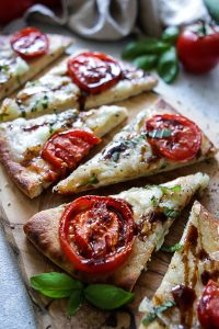 Margherita flatbread pizza drizzled with balsamic reduction